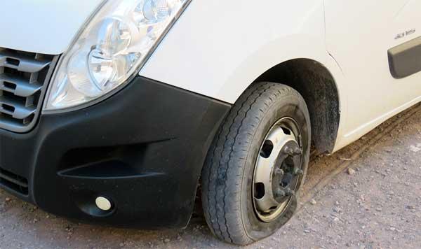 Broken tire on a desert tour in Morocco
