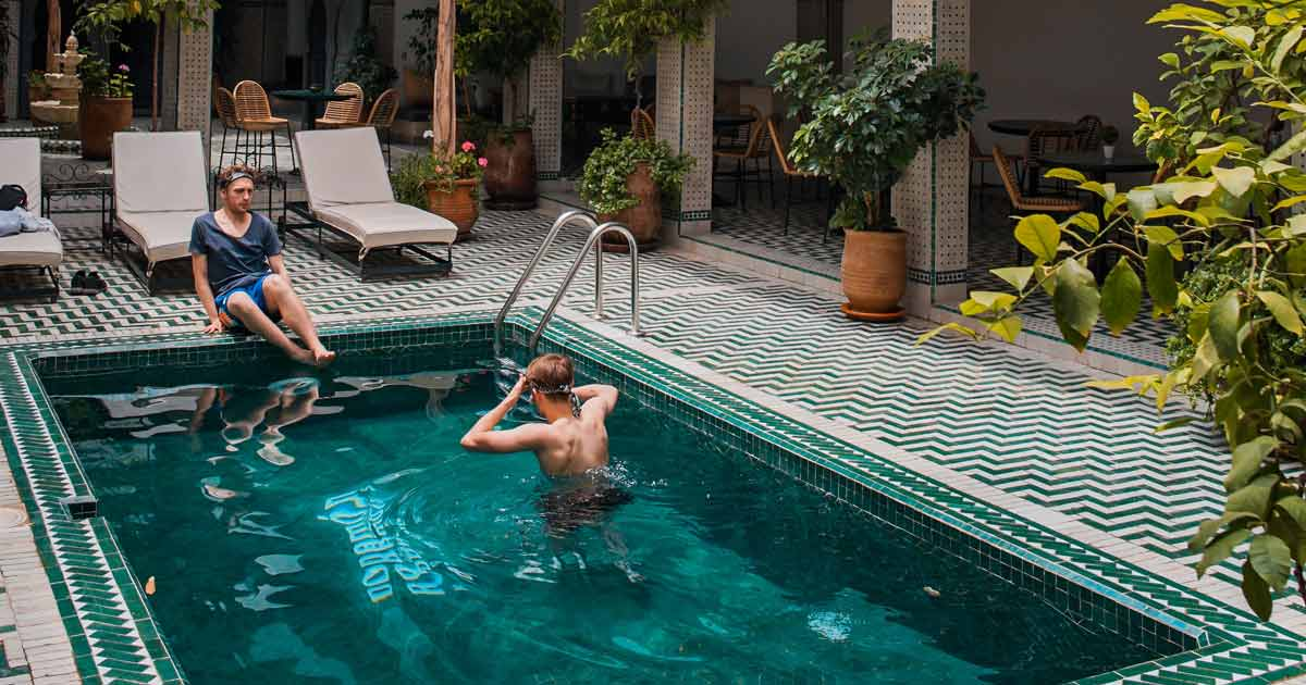 Unmarried couple in a pool in Marrakech, Morocco